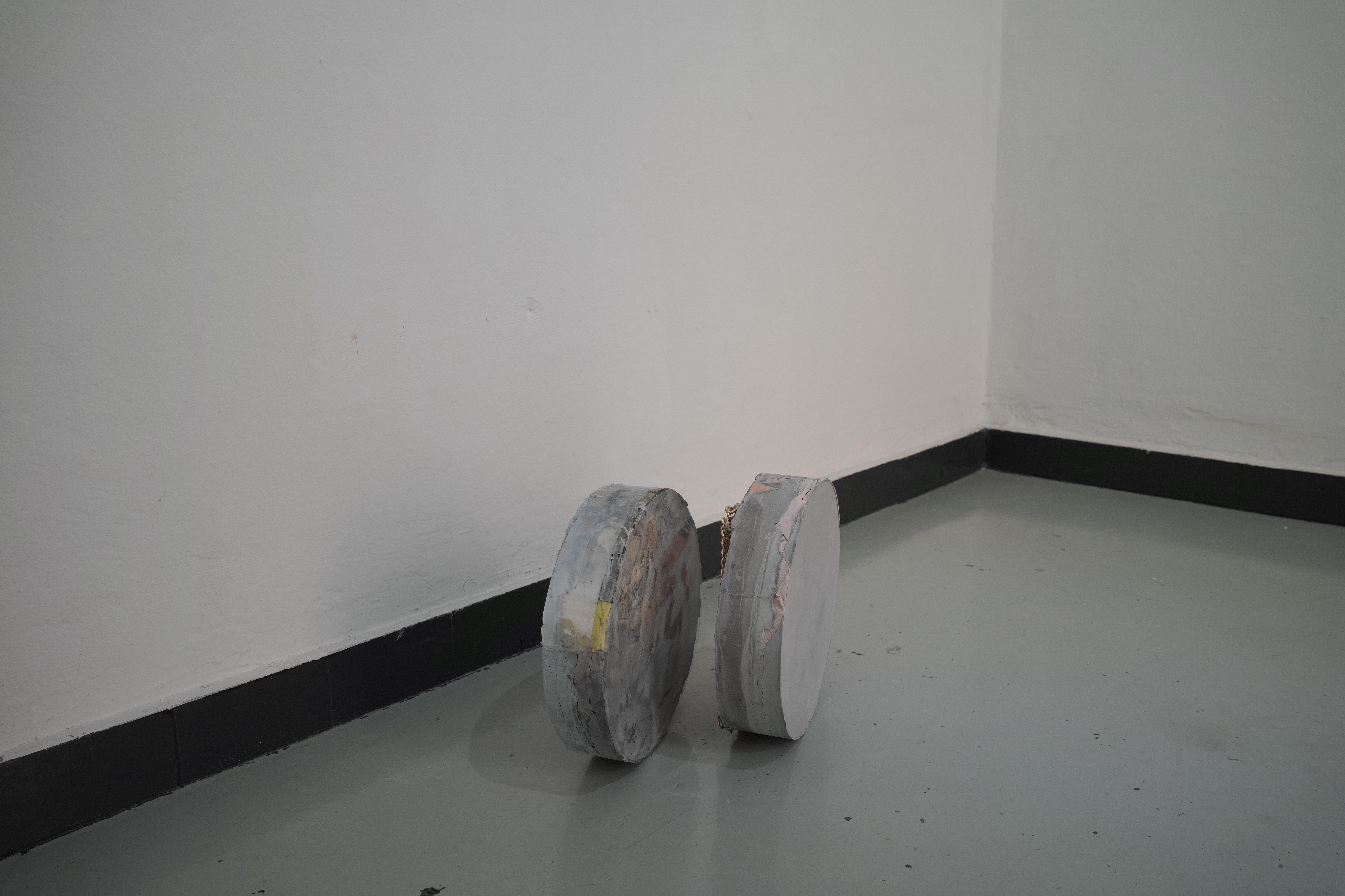 Multiple Distances, 2018 studio cast concrete, merchandise, computer parts, feathers, exhibition view (Parallels) at Space4235, Genova