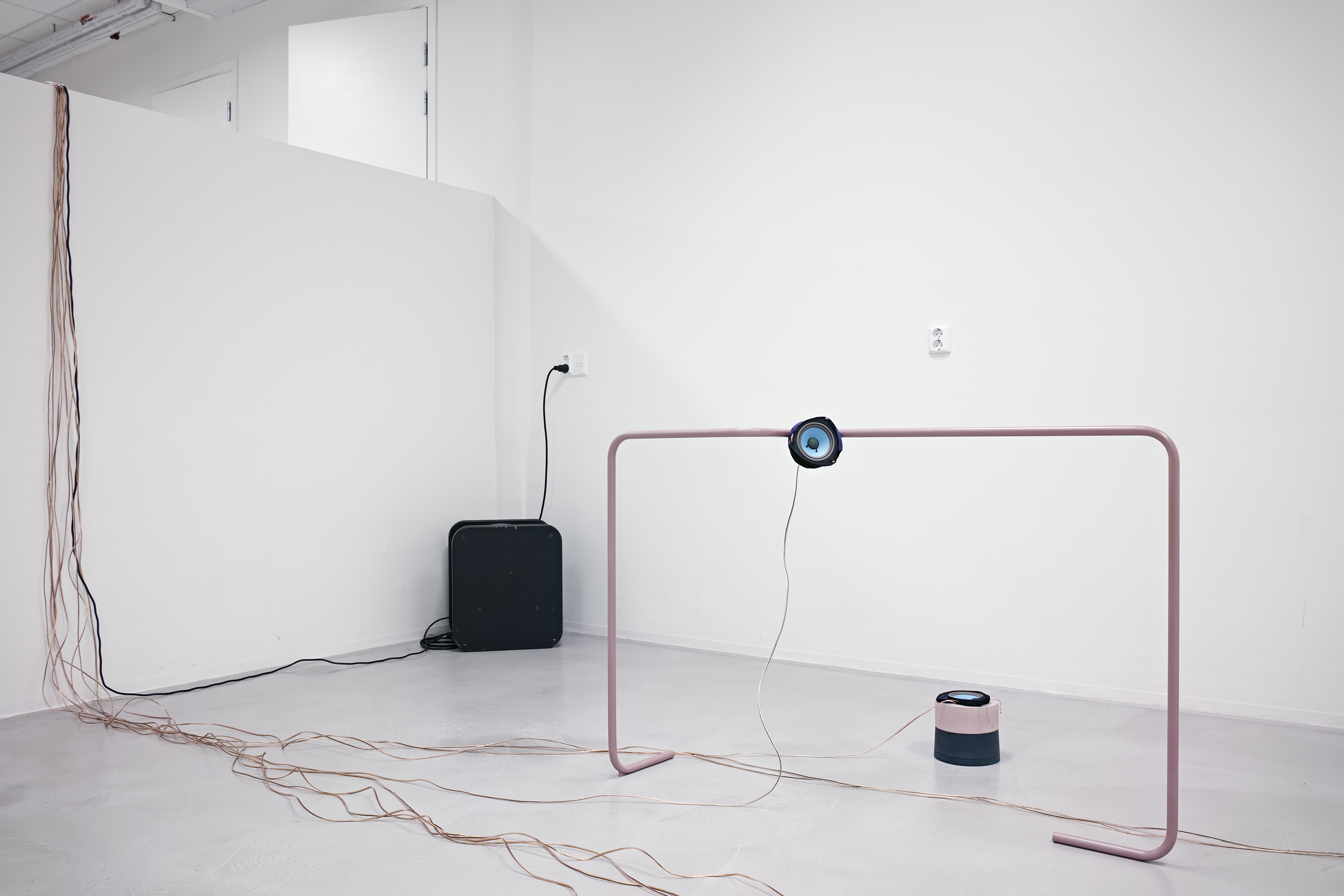 Installation view, powder-coated bent steel, copper audio cables, speaker, sub-woofer, pigmented Jesmonite, Lycra, Polyester fabric